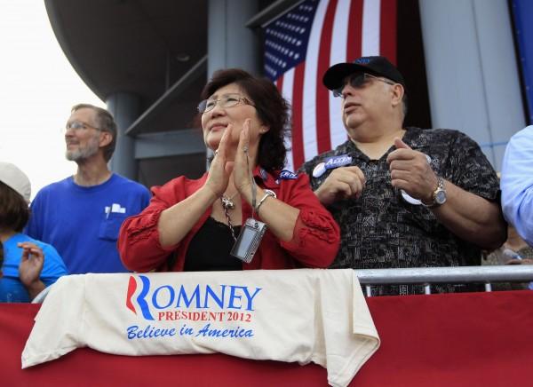 Supporters of Republican presidential candidate Mitt Romney wait for him to introduce Rep. Paul Ryan (R-WI) as his vice-presidential running mate during a campaign event at the battelship USS Wisconsin in Norfolk, Virginia  Aug. 11, 2012.