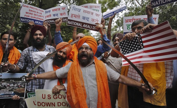 Activists from National Akali Dal, a regional Sikh political party, hold swords and shout slogans  in New Delhi Aug. 6 during a protest against Sunday's shooting at a Sikh temple in Wisconsin.