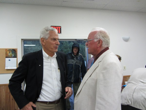Col. Kris Mineau speaks with Gordon Colby of the Knox-Lincoln County Tea Party during a meeting held Thursday evening in Warren.