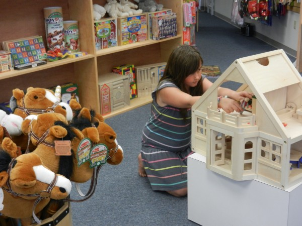 Robert O. Cupcake, a family-owned toy store in Bangor, has opened up at the Intown Plaza at 332 Harlow St. Jane Roe, the daughter of owners Nancy and Mark Roe, plays with an interactive doll house inside the store Wednesday afternoon.