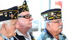 Veterans Dan St. Pierre of Auburn, left, Hugh Brown of Auburn, center, and Tibby Dupuis of Lewiston listen to speakers at the grand opening of the Veterans Administration clinic on Challenger Drive in Lewiston on Tuesday morning. To watch a video from the event, visit: sunjournal.com/cboc080712.