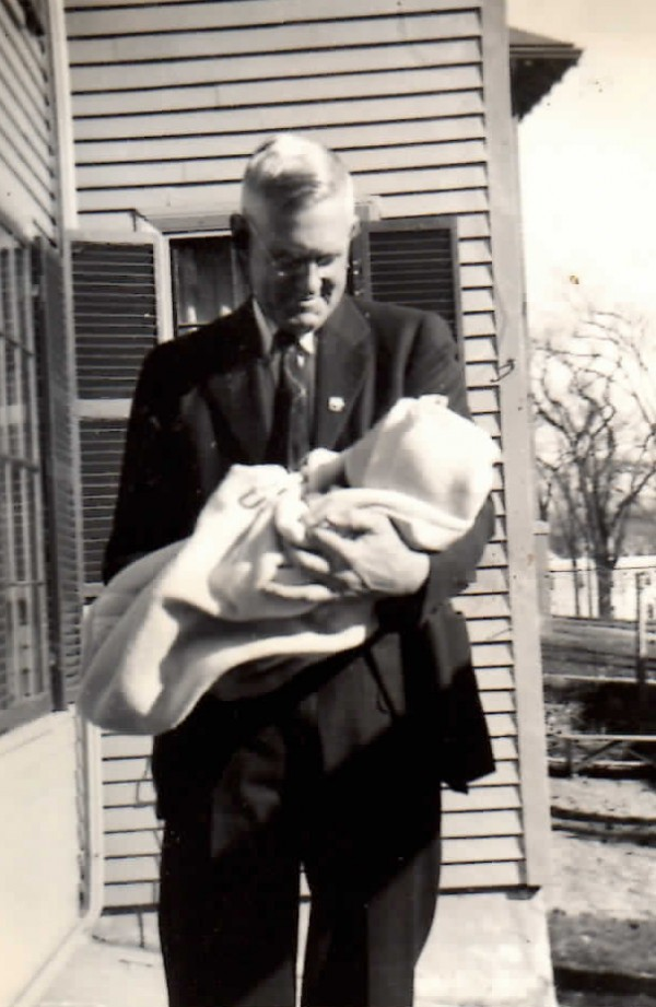 Dr. Hal Hunt holds his newborn granddaughter Margaret Thompson in this 1940 photo.