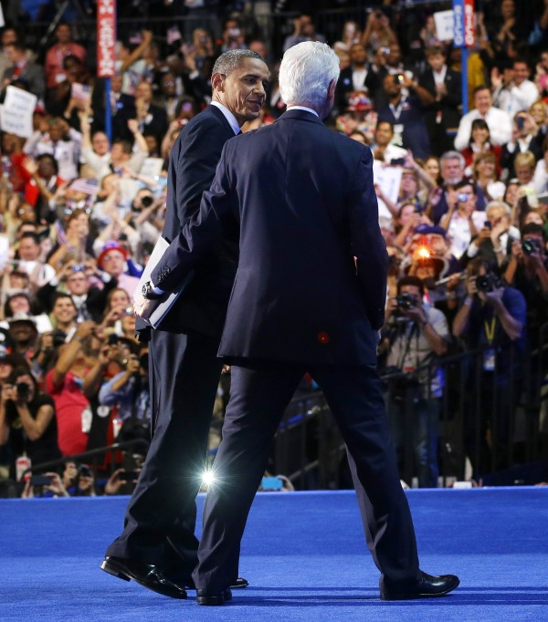 President Barack Obama, left, and former President Bill Clinton, right, walk off stage together at the Democratic National Convention.