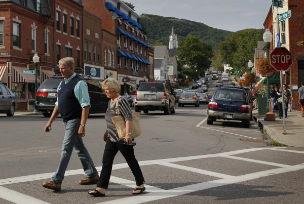 A couple strolls through Camden, Maine. The small coastal town is often cited in lists of best retirement places to move for people interested in cooler climates.