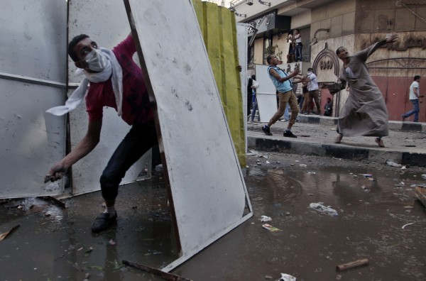 Protesters clash with security forces near the U.S. Embassy in Cairo.