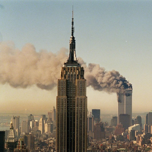 The twin towers of the World Trade Center burn behind the Empire State Building in New York in Sept. 11, 2001.