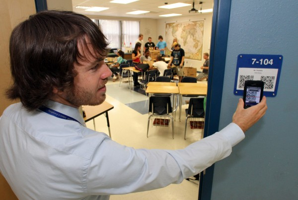 Kevin Franklin, 24, a world history teacher at South Lake High School in Groveland, uses his smartphone to demonstrate the use of a QR code that students can scan as they enter his classroom. Students get class information, project descriptions and a course calendar.