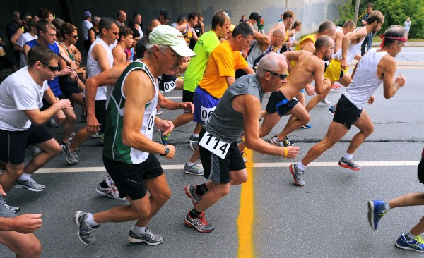 Competitiors take off at the start of the 50th annual 5-mile Labor Day Road Race in Bangor on Monday. It was the last time the current course will be used.