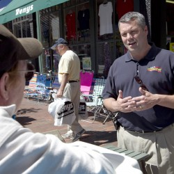 Republican candidate for 1st District House Jon Courtney, right,  talks with a shop owner on Front Street during his &quotSolutions from Main Street Tour&quot in Bath in July.