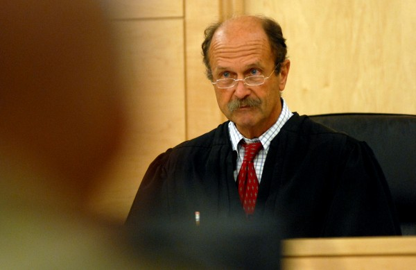 Justice William Anderson listens to arguments in traffic court at the Penobscot Judicial Center on Thursday.