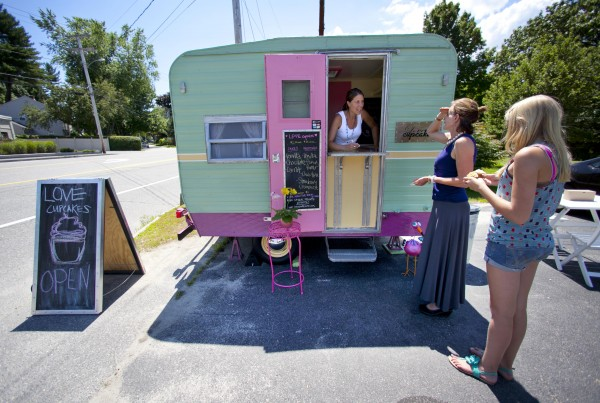 Anna Turcotte greets her customers to &quotLove Cupcakes,&quot a business she operates out of a tiny trailer on Route 1 in Falmouth.
