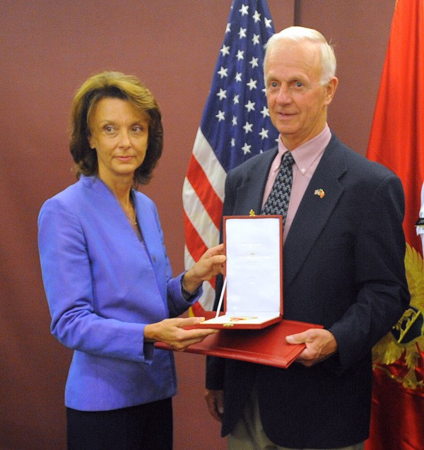 The minister of defense of Montenegro, Milica Pejanovic-Djurisic, presents retired Maj. Gen. John &quotBill&quot Libby with the Montenegrin Flag Medal in recognition of his work establishing the official State Partnership Program between the State of Maine and Montenegro Saturday, Sept. 8, 2012.