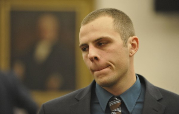 Garrett Cheney of South Berwick is escorted out of the courtroom after his sentencing in December 2011.