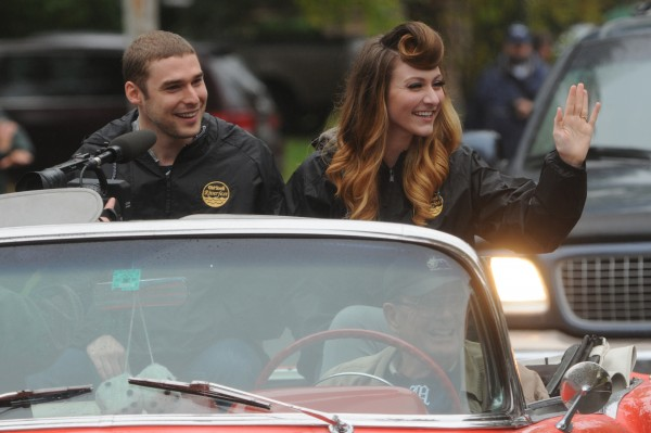 The pop duo of Amy Heidemann (right) and Nick Noonan (left), also known as Karmin, ride in a car during the Old Town Riverfest parade on Saturday, Sept. 29, 2012.
