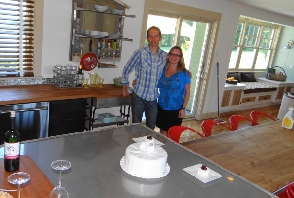 Dylan Eastman and Beverly Anderson of DIY Network pose in the kitchen of the house in Waldoboro that is being given away by the network.