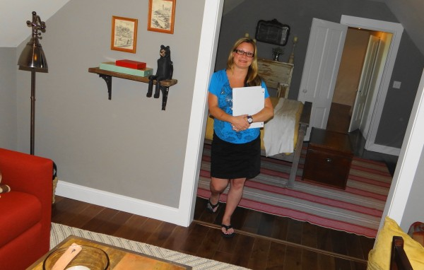 Beverly Anderson poses in the guest suite on the second floor of the DIY Network's Blog Cabin, which the network is giving away in an online sweepstakes.