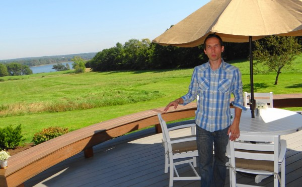 Dylan Eastman of DIY Network shows off the back deck of the network's Blog Cabin house in Waldoboro.