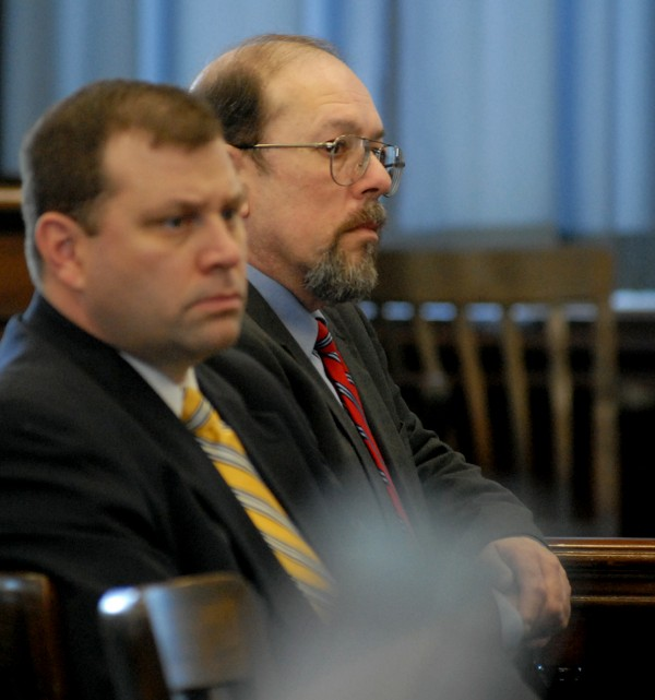 Jay Mercier (right) listens to closing arguments on Thursday, Sept. 27, 2012, in his trial for the 1980 murder of Rita St. Peter.