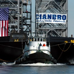 A barge loaded with steel modules made by Cianbro Corp. moves toward Searsport on the Penobscot River in 2009.  Cianbro has purchased a steel fabrication facility in Massachusetts.