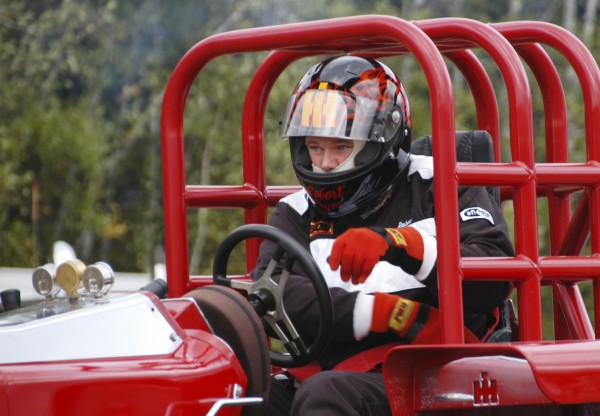 Robert Pryor, a  tractor driver from Centerville, New Brunswick, belts himself in before racing in the Northern Timber Cruisers Truck Pull at Millinocket Regional Airport in 2010.