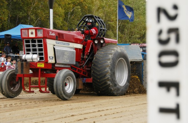 Peter Hurd of Morrill drives his tractor, Flirtin' With Disaster, hard during the Northern Timber Cruisers Truck Pull at Millinocket Regional Airport in 2010. The tractor was digging in to the track so deeply that it could barely keep its front wheels on the ground during its run down the track.