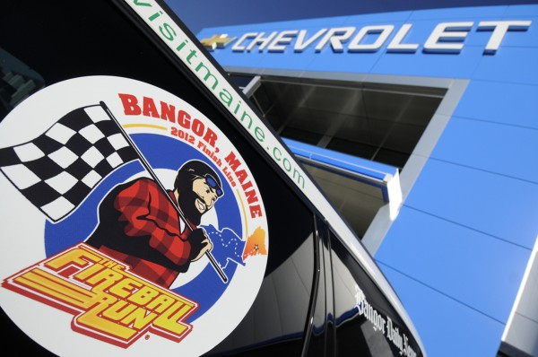 Bangor Fireball Run Adventurally Team logo is affixed to a tinted window of the Bangor team's car, a Chevrolet SUV.