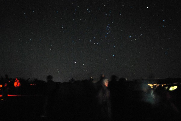 People appear as ghostly blurs beneath the clear night sky in this time-lapse photo taken during a &quotStar Party&quot atop Cadillac Mountain on Friday Sept. 15, 2012, during the Acadia Night Sky Festival.