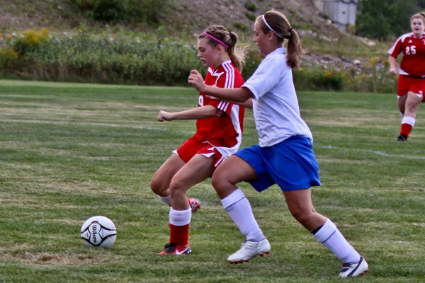 Fort Fairfield's Janae Libby (left) gets away from Easton's Sara Plourde en route to scoring on a breakaway during a game in Easton in August 2010. Many Aroostook County teams begin their games in August because the schools break in mid-September for the potato harvest.