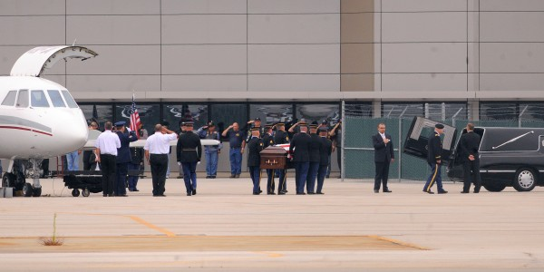 Staff Sgt. Jessica Wing's casket is carried from an airplane to a waiting hearse in Bangor on Friday. Wing's death in Kuwait was non-combat-related. She was a helicopter crew chief assigned to the 1st Battalion, 126th Air Medevac Company out of Bangor.