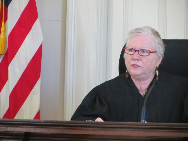 Superior Court Justice Joyce Wheeler denied a defense motion Friday morning to dismiss the promotion of prostitution charge against Mark W. Strong Sr.