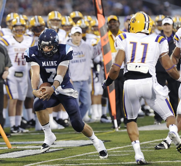 Maine quarterback Marcus Wasilewski (7) is run out of bounds on a carry by Albany linebacker Jon Morgan (11) in the first half of an  NCAA college football game in Orono on Saturday, Sept. 22, 2012.