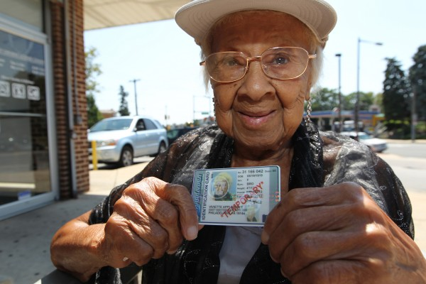 On Thursday, August 16, 2012, 93-year-old Viviette Applewhite holds up the temporary photo ID she was able to obtian in Philadelphia, Pennsylvania. She wants to be able to vote in the next election and was able to overcome obstacles to meet the legal restrictions of the state's new voter identification law. &quotYou just have to keep trying,&quot Applewhite said. &quotDon't give up.&quot