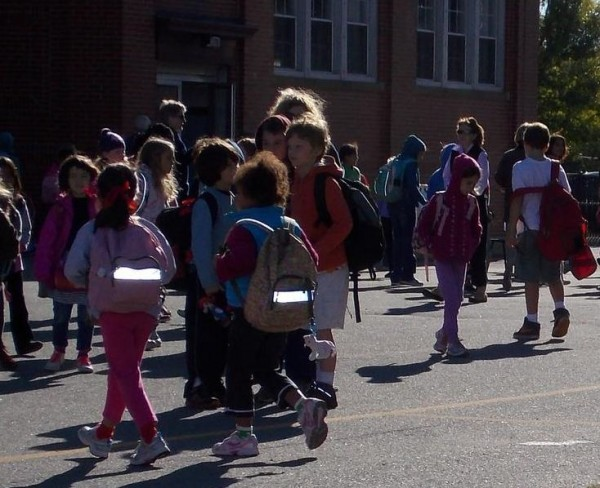 Hall Elementary School's 435 students headed back to school Tuesday, Sept. 25, 2012, but not at their home campus. Until further notice students will continue their classes at the old Cathedral School on Locust Street in Portland.
