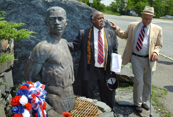 James Varner (left), executive director of the Maine Human Rights Coalition, speaks next to Brewer mayor Arthur Verow after placing a wreath next to the &quotNorth to Freedom&quot statue at the fifth annual Juneteenth Day celebration, which honors the freeing of slaves in the U.S., at Chamberlain Freedom Park in Brewer on Friday, June 18, 2010.