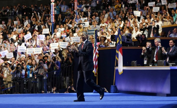 President Barack Obama walks out on stage to greet former President Bill Clinton on Wednesday, Sept. 5, 2012, at the Democratic National Convention in Charlotte, N.C.