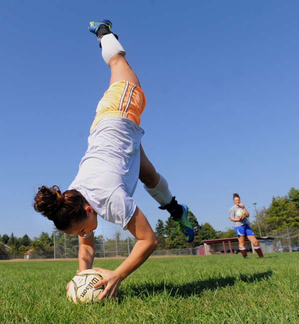 Ellsworth High Shool varsity soccer player Cristin Wright makes a flip-throw during practice Friday.  Wright and her teammate Emily Berry (right) are the two players on the team who use this technique, enabling them to throw the ball a greater distance.