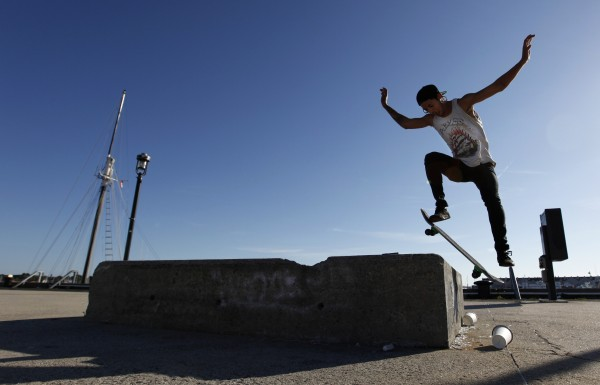 Skateboarder Ricky Vaccarro, 21, performs an &quotOllie on, 180 off,&quot on a cement block in the middle the Maine State Pier.