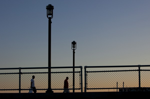 Fishermen head for home at the end of the day on the Maine State Pier.