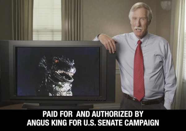 This still frame from a campaign video advertisement released by the Angus King for Senate campaign, shows King in Maine, with an image of Godzilla on a monitor. King, an independent and former governor, says his opponents are trying to portray him as a monster in the race for the November general election.