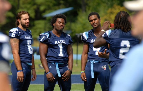 "University of Maine football player Maurice McDonald (2) takes a picture of teammates Troy Eastman, Donte Dennis, and Troy Russell (left to right) during the Black Bears media day at Alfond Stadium on Aug. 17. Maine plays its home opener against Albany at 6 p.m. Saturday when the university rolls out what it hopes will be a more festive and enjoyable game-day atmosphere for its students and fans with ""Black Bear Fanfair."""