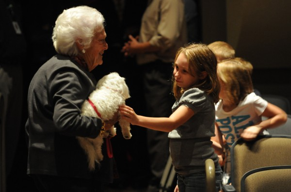 Barbara Bush and her dog Mini-Me are greeted by Brewer Community School students after she and Maine first lady Ann LePage visted the school on Monday, Sept. 17, 2012.