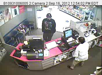 The suspect in a Rite Aid Pharmacy robbery in Newport is captured in a surveillance photo Sunday, Sept. 16.
