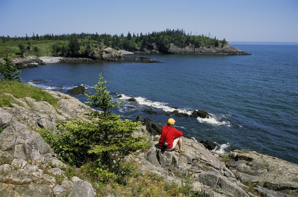Hiker Melissa Paly enjoys the beauty of the Hamilton Cove Preserve in Lubec. Hamilton Cove is managed by Maine Coast Heritage Trust and is open to the public for day use.