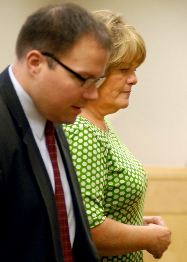 Patricia Giles, accused of a fatal hit-and-run on Main Street in Bangor in June, pleaded not guilty at her arraignment Wednesday morning at the Penobscot Judicial Center. Standing with Giles is attorney Zachary Brandmeir.