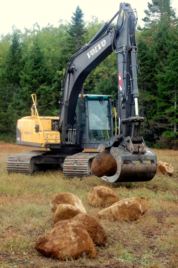 Now that the last of the company's 300 acres of wild blueberries have been picked, Hennessey Brothers is busy picking rocks out of its 300 acres of barrens in Jonesboro. Ernie Spaulding of Danforth jumped in his excavator at 3 a.m. Friday, Sept. 21, 2012 for a long day of clearing boulders from a barren off Route 1.