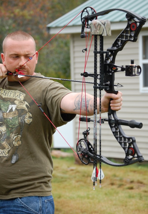 Louis Doyon of Lewiston, Maine, is the only bow hunter in this week's group of veterans stalking black bear in Maine's remote Washington County.