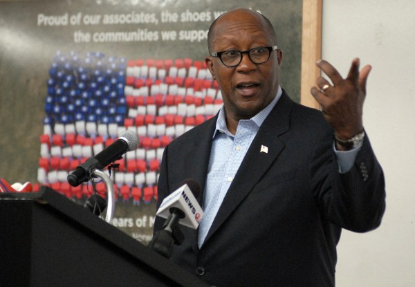 Ambassador Ron Kirk, U.S. Trade Representative, talks to the press and employees of the New Balance manufacturing plant in Norridgewock after taking a tour of the facility on Thursday.