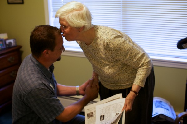 Peter Henckel, program coordinator with Cape Memory Care in Cape Elizabeth, gets a kiss from resident Barbara Champeon on Thursday, Sept. 27, 2012 before walking her to lunch