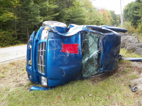 Jacob Moores, 21, of Orono, escaped this accident with only minor injuries, said State Trooper Mike Southard on Monday, Sept. 24, 2012. Moores had been driving south on Bald Mountain Road in Dedham when he reached for his cellphone, causing him to leave the road and roll over, Southard said.