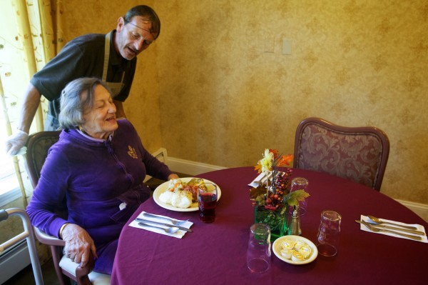 Ralph Galyean takes a moment to help Dorothy Green with her chair after serving her lunch at Cape Memory Care in Cape Elizabeth on Thursday, Sept. 27, 2012.
